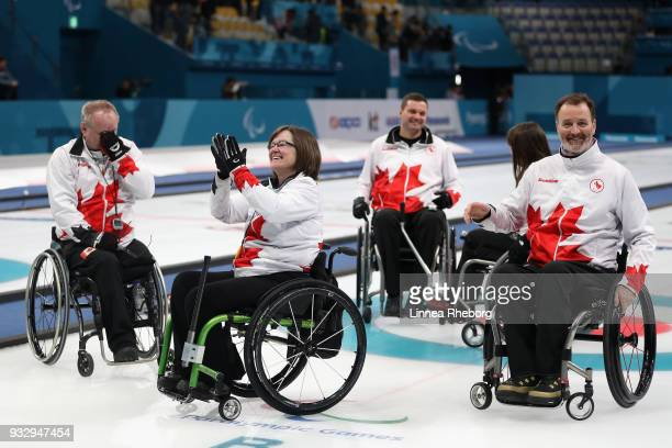 Dennis Thiessen Marie Wright Mark Ideson Ina Forrest and Jaime Anseeuw of Canada reacts after winning the Curling Mixed Bronze Medal match between...