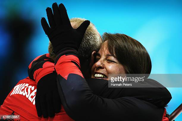 Dennis Thiessen of Canada celebrates with Ina Forrest after winning the semifinal match between China and Canada on day eight of Sochi 2014...
