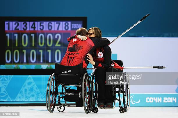 Dennis Thiessen of Canada celebrates with Sonja Gaudet after winning the semifinal match between China and Canada on day eight of Sochi 2014...