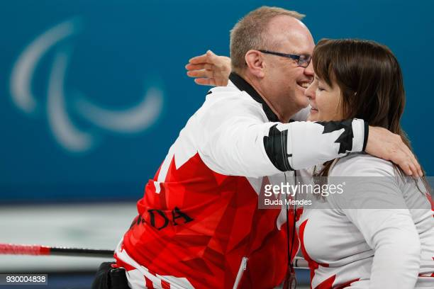 Dennis Thissen and Ina Forrest of Canada celebrates the victory in the Wheelchair Curling Round Robin Session 01 during day one of the PyeongChang...