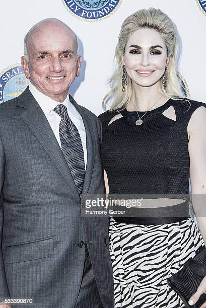 Dennis Tito and Elizabeth TenHouten arrive at the SEALNavy Special Warfare Family Foundation 3rd Annual Gala Dinner Arrivals on May 21 2016 in...