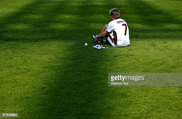 Dennis Tornieporth of Pauli sits on the grass after the final whistle of the Third League match between Rot Weiss Essen and FC StPauli at the...