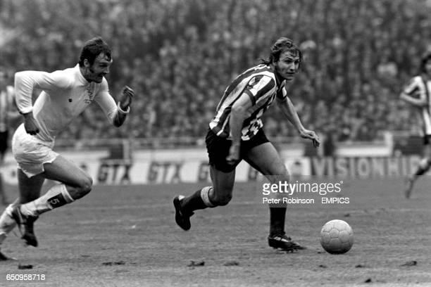 Dennis Tueart of Sunderland gets away from Leeds United's Paul Madeley