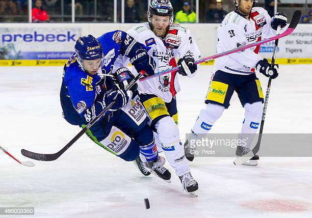 Dennis Urban of Straubing Tigers and Florian Busch of the Eisbaeren Berlin during the game between the Straubing Tigers and the Eisbaeren Berlin on...