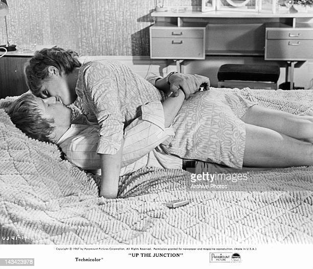 Dennis Waterman and Suzy Kendall making out in the bed in a scene from the film 'Up The Junction' 1967