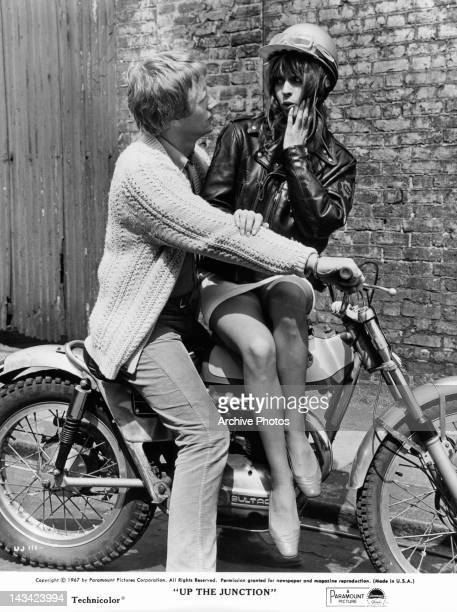 Dennis Waterman and Suzy Kendall on motor bike together in bed together in a scene from the film 'Up The Junction' 1967