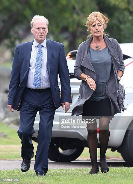 Dennis Waterman and wife Pam Flint attends the funeral of George Cole at Reading Crematorium on August 13 2015 in Reading England