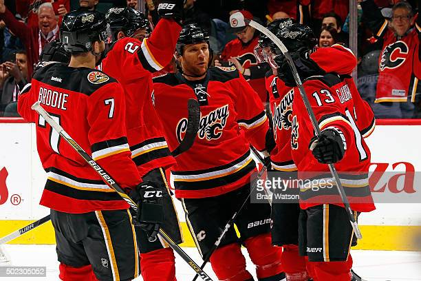 Dennis Wideman Johnny Gaudreau and teammates of the Calgary Flames celebrate a goal against the Winnipeg Jets during an NHL game at Scotiabank...
