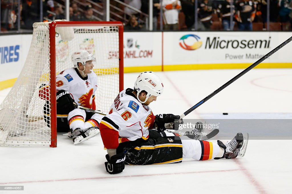 Dennis Wideman #6 of the Calgary Flames and Joe Colborne #8 of the Calgary Flames react to an empty net goal by Ryan Kesler #17 of the Anaheim Ducks during the third period of a game at Honda Center on November 24, 2015 in Anaheim, California.