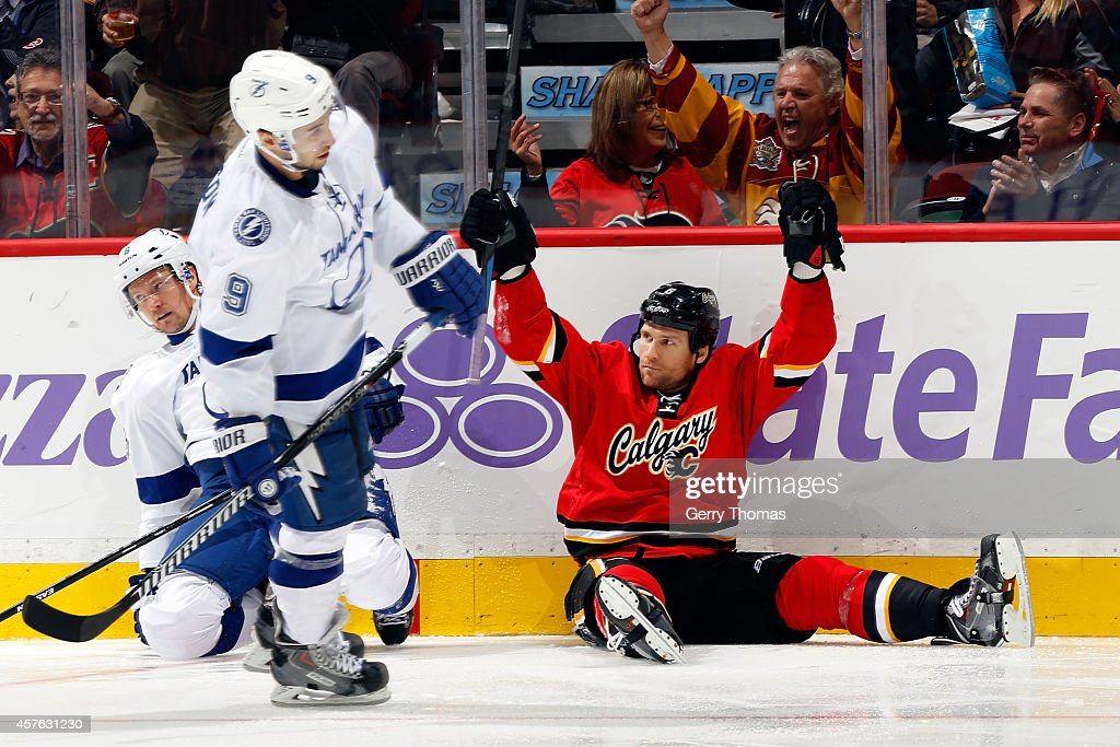 Dennis Wideman #6 of the Calgary Flames celebrates a goal against the Tampa Bay Lightning at Scotiabank Saddledome on October 21, 2014 in Calgary, Alberta, Canada.