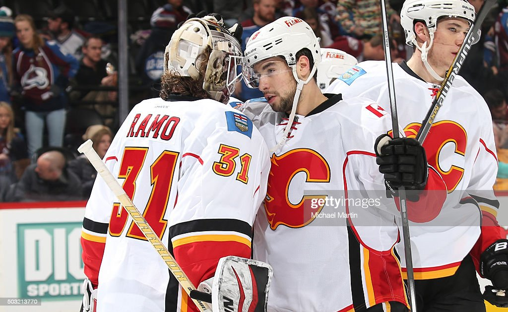 Dennis Wideman #6 of the Calgary Flames congratulates Goaltender Karri Ramo #31 after their win against the Colorado Avalanche at the Pepsi Center on January 2, 2016 in Denver, Colorado. The Flames defeated the Avalanche 4-0.