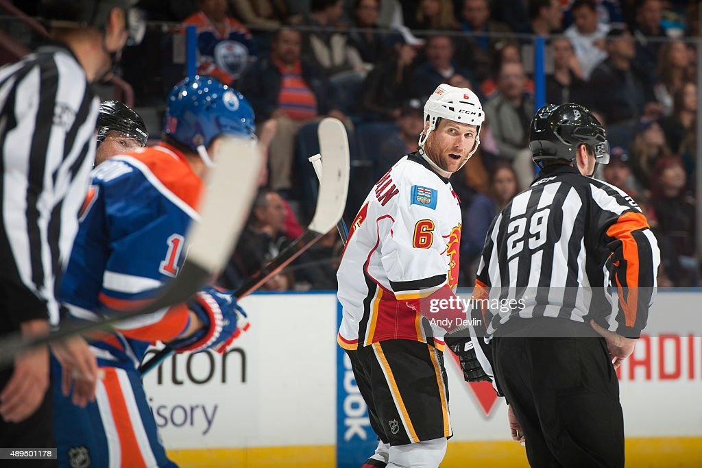 Dennis Wideman #6 of the Calgary Flames exchanges words with Nail Yakupov #10 of the Edmonton Oilers on September 21, 2015 at Rexall Place in Edmonton, Alberta, Canada.