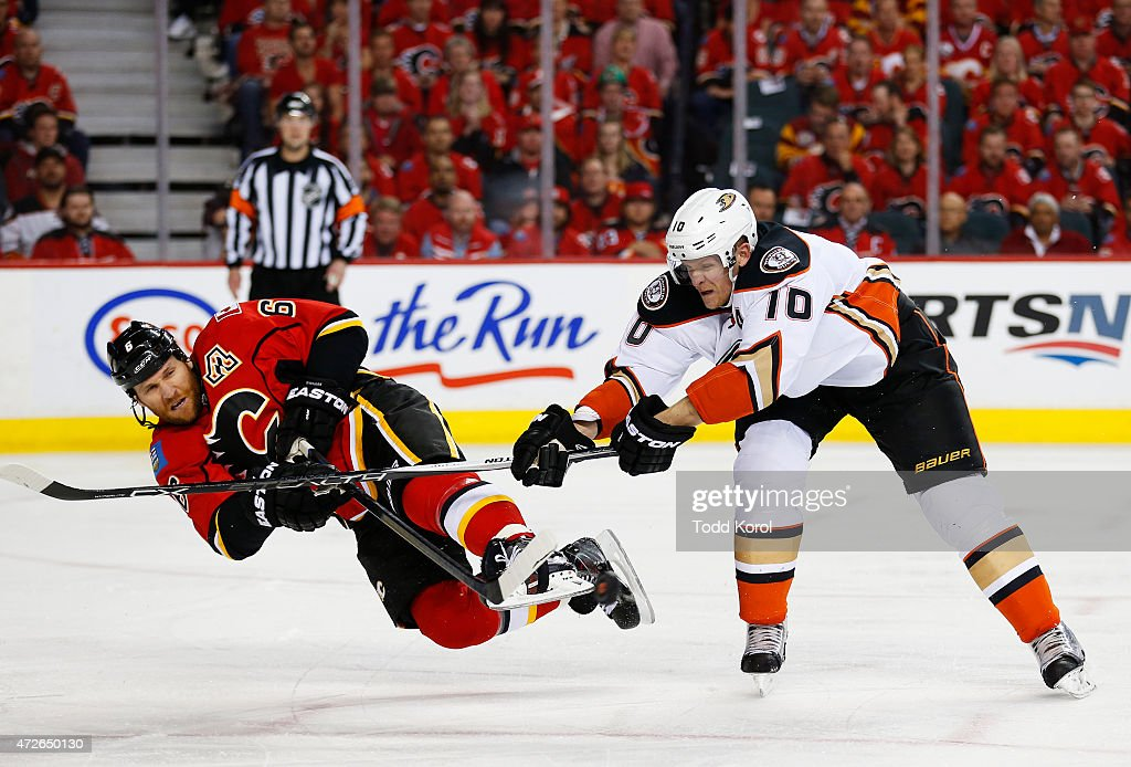 Dennis Wideman #6 of the Calgary Flames is sent flying by Corey Perry #10 of the Anaheim Ducks in Game Four of the Western Conference Semifinals during the 2015 Stanley Cup Playoffs at the Scotiabank Saddledome on May 8, 2015 in Calgary, Alberta, Canada.