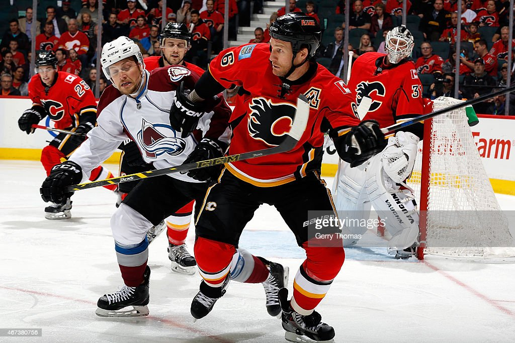 Dennis Wideman #6 of the Calgary Flames skates against Tyson Barrie #4 of the Colorado Avalanche at Scotiabank Saddledome on March 23, 2015 in Calgary, Alberta, Canada.