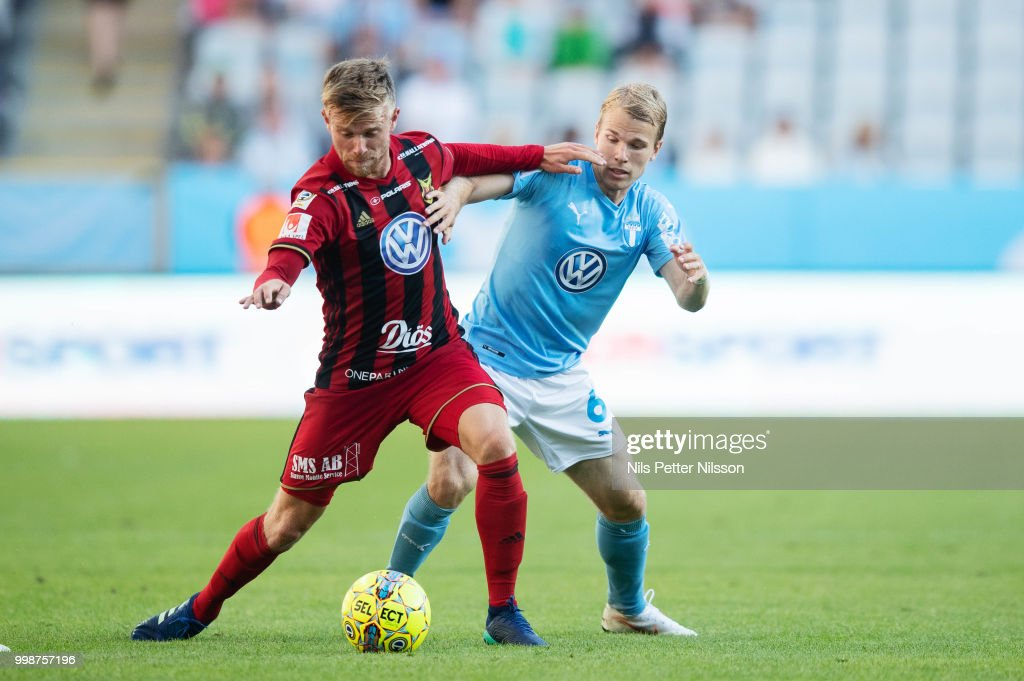 Dennis Widgren of Ostersunds FK and Oscar Lewicki of Malmo FF competes for the ball during the Allsvenskan match between Malmo FF and Ostersunds FK at Malmo Stadion on July 14, 2018 in Malmo, Sweden.