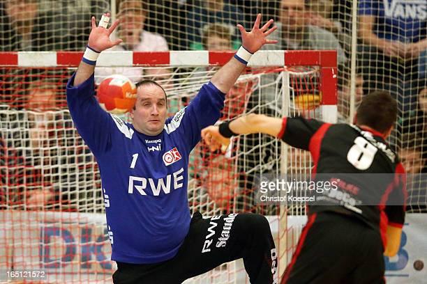 Dennis Wilke of Tus N-Luebbecke scores a seven-meter shot against Jan Kulhanek of TUSEM Essen during the DKB Handball Bundesliga match between TUSEM...