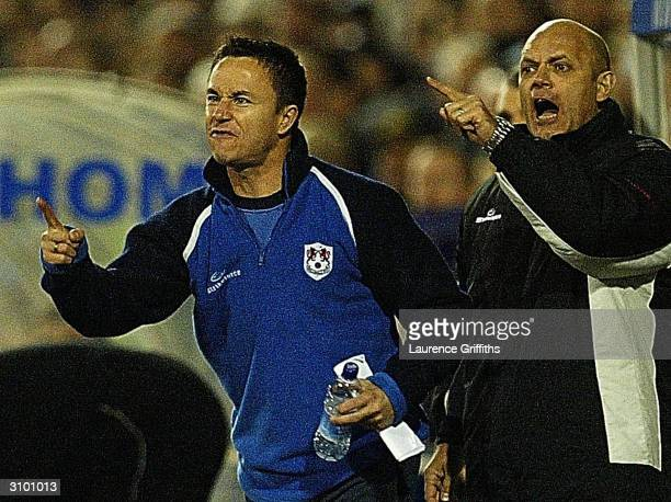 Dennis Wise and Ray Wilkins of Millwall give out their instruction from the bench during the FA Cup Quarter Final Replay match between Tranmere...