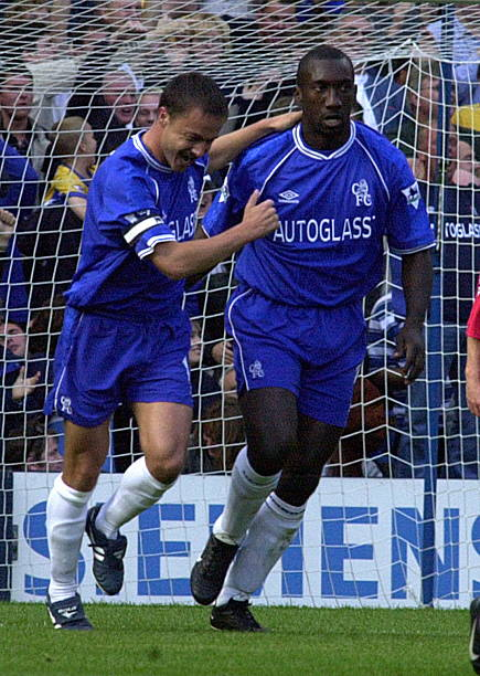 Dennis Wise congratulates Jimmy Floyd Hasselbank after he had scored Chelsea's second goal against Liverpool 01 October 2000 during their premiership...