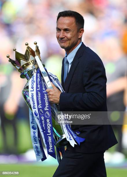 Dennis Wise ex Chelsea player brings the Premier League Trophy after the Premier League match between Chelsea and Sunderland at Stamford Bridge on...