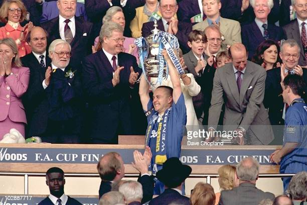 Dennis Wise of Chelsea lifts the trophy after the FA Cup Final between Chelsea and Middlesbrough held on May 17 2010 at Wembley Stadium in London...