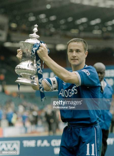 Dennis Wise of Chelsea poses with the FA Cup after their victory over Aston Villa in the FA Cup Final at Wembley Stadium on May 20 2000 in London...