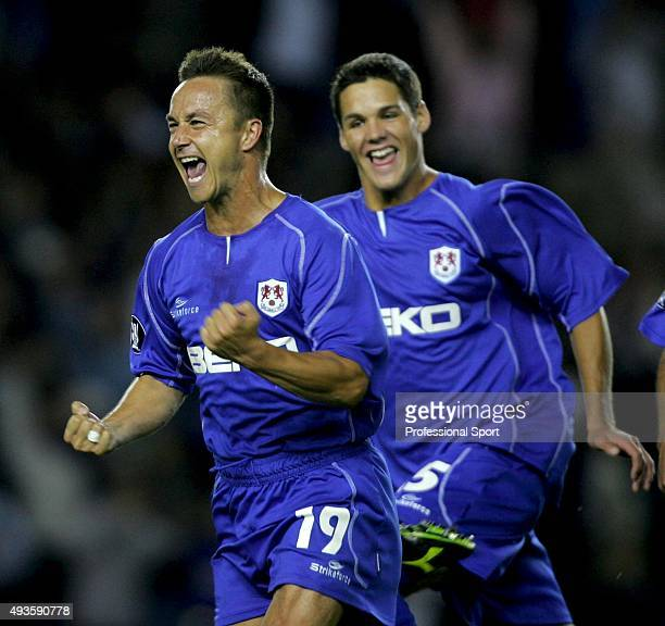 Dennis Wise of Millwall celebrates his goal during the UEFA Cup first round first leg match between Millwall and Ferencvaros at The New Den on...