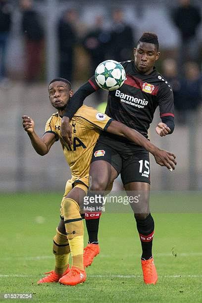 DennisMukuna Mbay of Leverkusen battles for the ball with Japhet Tanganga of Tottenham during the UEFA Youth Champions League match between Bayer...