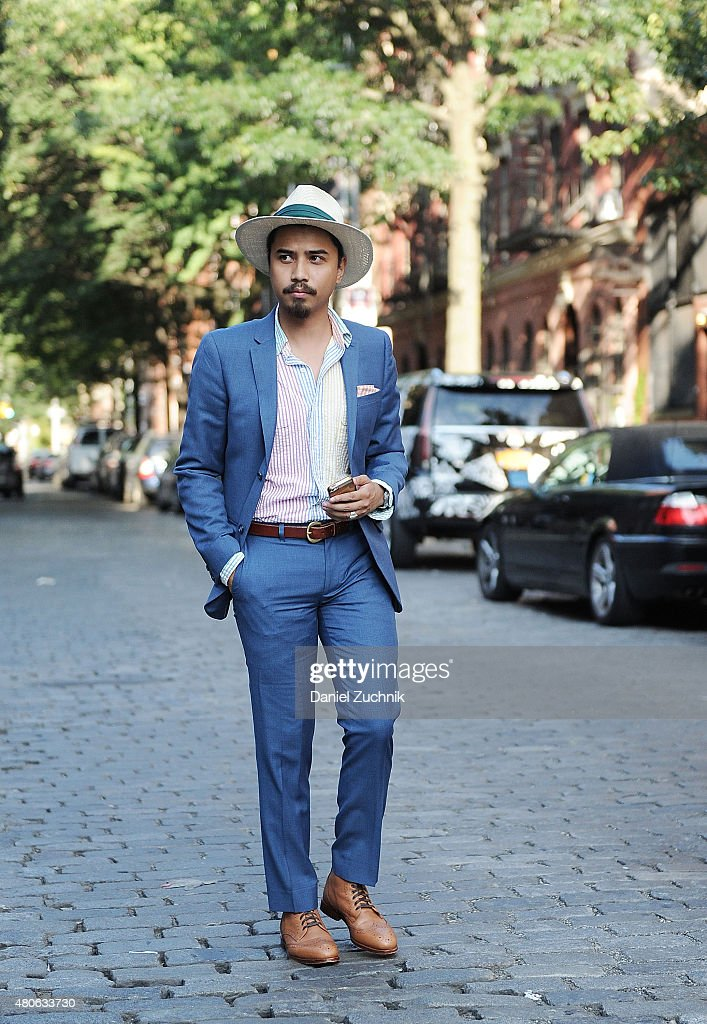 Denny Balmaceda is seen outside the Carlos Campos show wearing a Topman suit, vintage Ralph Lauren top with a vintage hat during New York Fashion Week: Men's S/S 2016 at Industria Studio on July 13, 2015 in New York City.