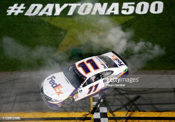 Denny celebrates after winning the Monster Energy NASCAR Cup Series 61st Annual Daytona 500 at Daytona International Speedway on February 17 2019 in...