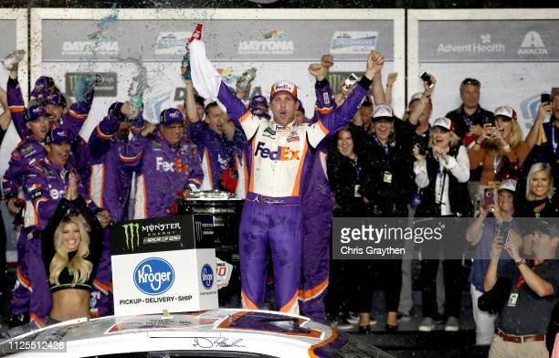 Denny celebrates in Victory Lane after winning the Monster Energy NASCAR Cup Series 61st Annual Daytona 500 at Daytona International Speedway on...