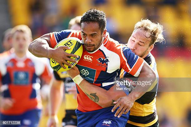 Denny Godinet of the Rams is tackled by Bill Meakes of the Spirit during the round three NRC match between the Western Sydney Rams and the Perth...