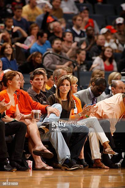 Denny Hamlin after his race is seen sitting next to Jordan Fish during the game of the Charlotte Bobcats against Antoine Wright of the Toronto...