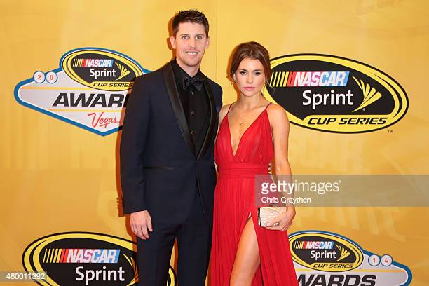 Denny Hamlin and his girlfriend Jordan Fish arrive on the red carpet prior to the 2014 NASCAR Sprint Cup Series Awards at Wynn Las Vegas on December...