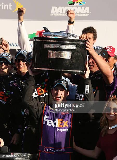 Denny Hamlin celebrates in Victory Lane after winning the Daytona 500 NASCAR Sprint Cup race at Daytona International Speedway in Daytona Beach Fla...