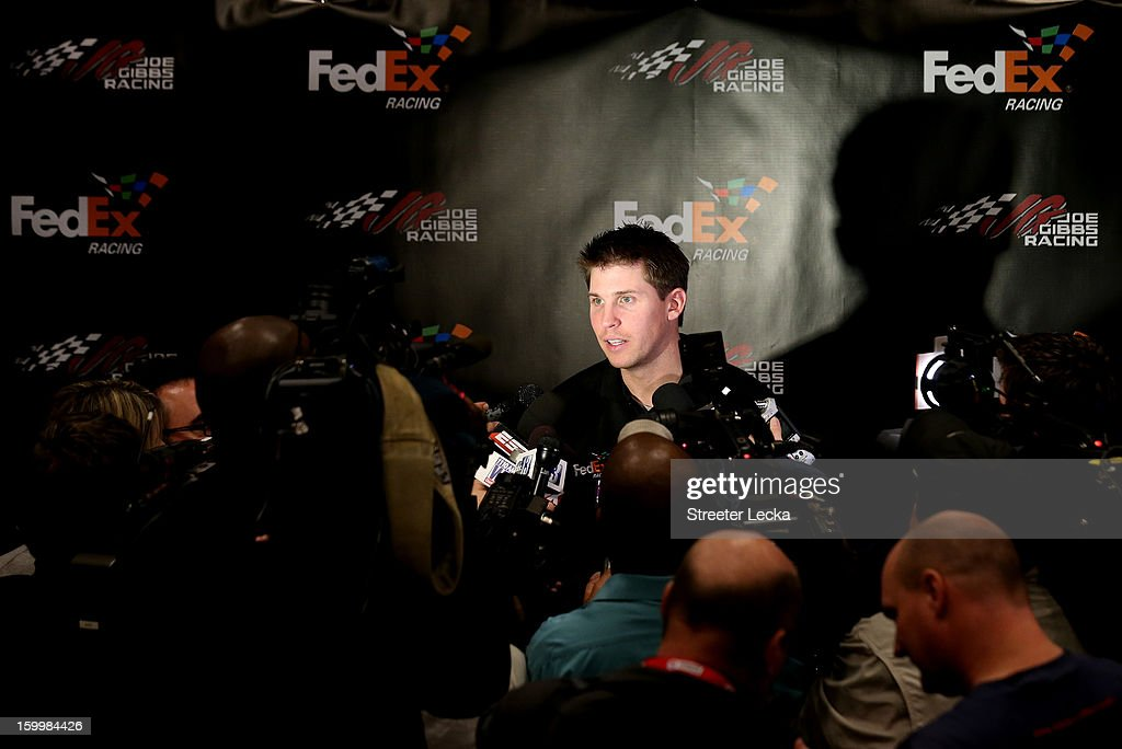 Denny Hamlin, driver for Joe Gibbs Racing, speaks to the media during the 2013 NASCAR Sprint Media Tour on January 24, 2013 in Concord, North Carolina.
