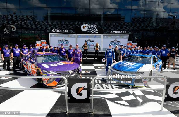 Denny Hamlin driver of the FedEx Express Toyota and Alex Bowman driver of the Nationwide Chevrolet pose for a photo after winning the pole award...