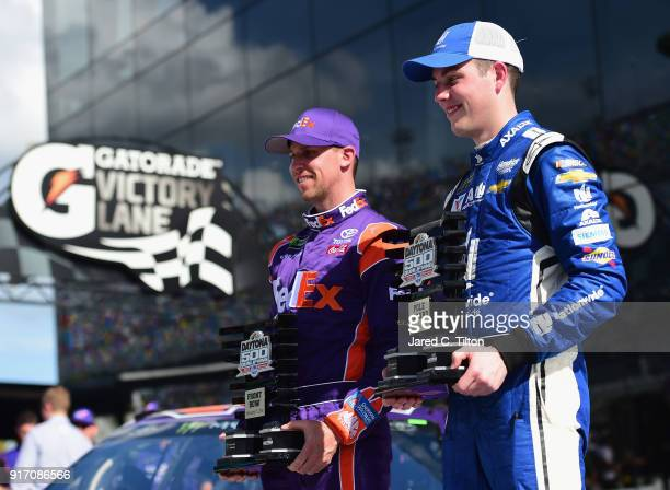 Denny Hamlin driver of the FedEx Express Toyota and Alex Bowman driver of the Nationwide Chevrolet pose for a photo after winning the pole award for...