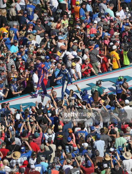 Denny Hamlin driver of the FedEx Express Toyota and Alex Bowman driver of the Nationwide Chevrolet are introduced during pre race festivities prior...