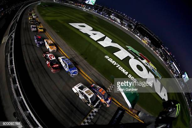 Denny Hamlin driver of the FedEx Express Toyota and Aric Almirola driver of the Smithfield Ford lead the field in the final restart during the...