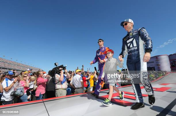 Denny Hamlin driver of the FedEx Express Toyota and Jamie McMurray driver of the Cessna McDonald's Chevrolet are introduced onstage during the 59th...