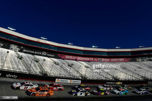 Denny Hamlin, driver of the FedEx Express Toyota, and Joey Logano, driver of the Autotrader Ford, lead the field during the NASCAR Cup Series Food...