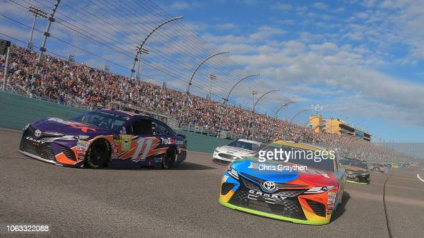 Denny Hamlin driver of the FedEx Express Toyota and Kyle Busch driver of the MM's Toyota lead the field during pace laps prior to the Monster Energy...