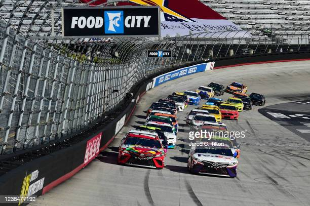 Denny Hamlin, driver of the FedEx Express Toyota, and Kyle Busch, driver of the Skittles Toyota, lead the field during the NASCAR Cup Series Food...
