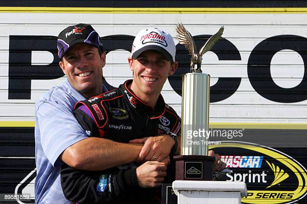 Denny Hamlin driver of the FedEx Express Toyota and team owner JD Gibbs pose in victory lane after winning the NASCAR Sprint Cup Series Sunoco Red...