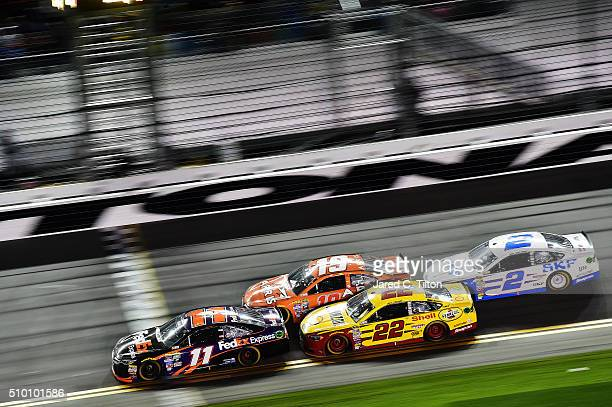 Denny Hamlin driver of the FedEx Express Toyota Carl Edwards driver of the ARRIS Toyota Joey Logano driver of the Shell Pennzoil Ford and Brad...