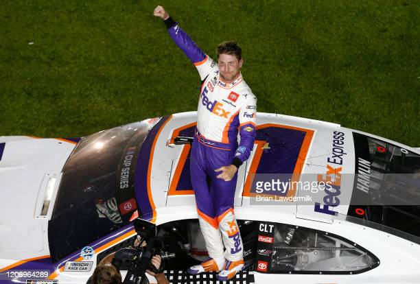Denny Hamlin driver of the FedEx Express Toyota celebrates after winning the NASCAR Cup Series 62nd Annual Daytona 500 at Daytona International...