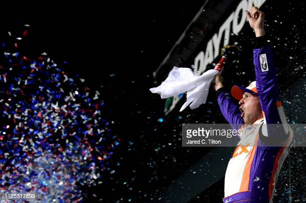 Denny Hamlin driver of the FedEx Express Toyota celebrates in victory lane after winning the Monster Energy NASCAR Cup Series 61st Annual Daytona 500...
