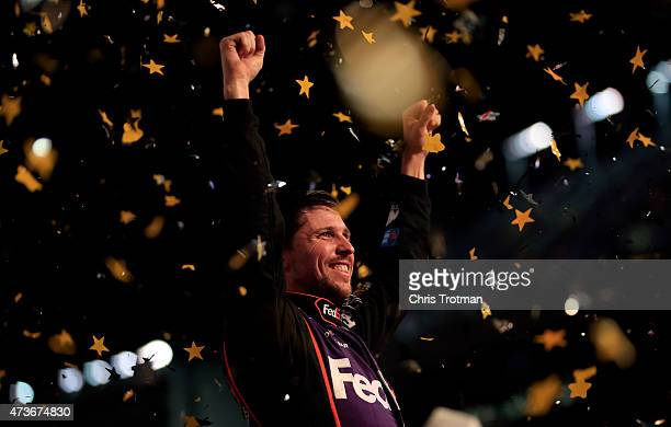 Denny Hamlin, driver of the FedEx Express Toyota, celebrates in victory lane after winning the NASCAR Sprint Cup Series Sprint All-Star Race at...