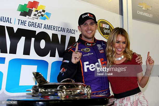 Denny Hamlin driver of the FedEx Express Toyota celebrates in Victory Lane with his wife Jordan Fish after winning the NASCAR Sprint Cup Series...