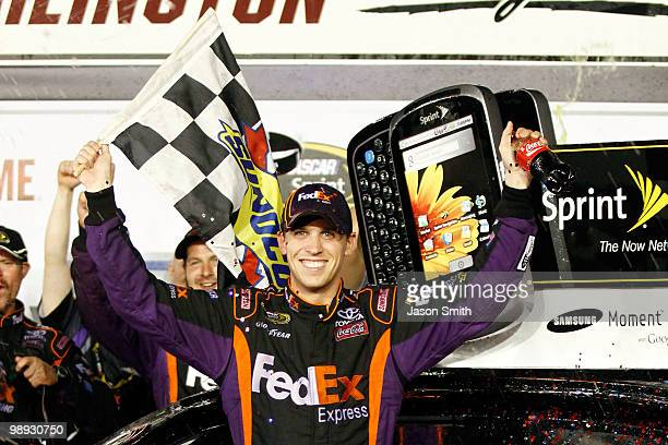 Denny Hamlin driver of the FedEx Express Toyota celebrates in victory lane after he won the NASCAR Sprint Cup series SHOWTIME Southern 500 at...
